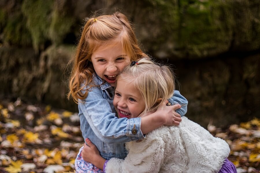 Two young girls hugging