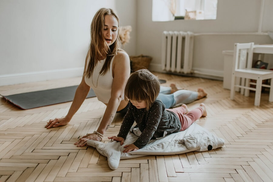 Mother and child do yoga together