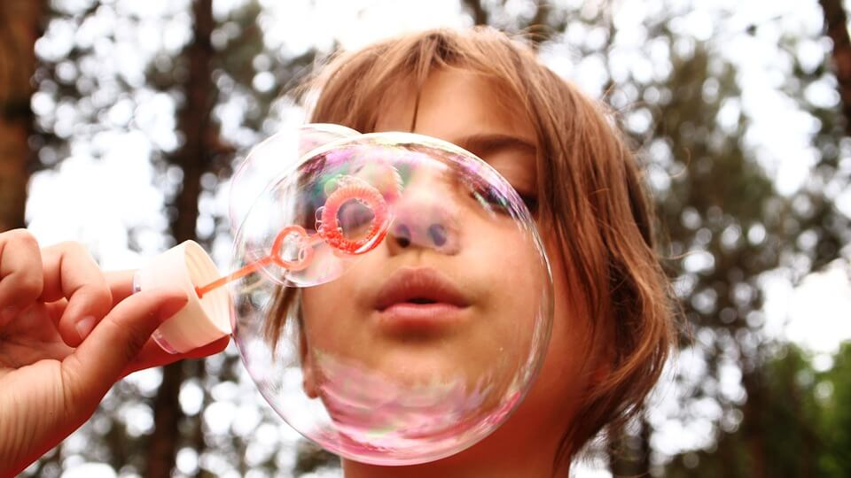 Girl blowing bubbles at camp